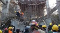 Rescue workers at the cement factory