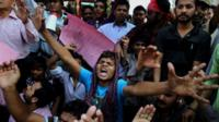 Pakistani Christians chant slogans during demonstration to condemn the suicide bombing attack on two churches, Sunday, March 15, 2015