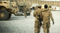 A US soldier from the 3rd Cavalry Regiment walking with the unit's Afghan interpreter