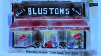 Painting of Blustons clothes shop facade
