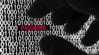 A hand grabs the word password written on a screen of ones and noughts