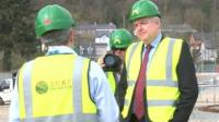 Carwyn Jones sees building work a new surfing centre in Dolgarrog, Snowdonia