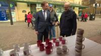 Adam Fleming with mug stall in Northampton