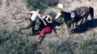 Policemen kicking and beating suspect