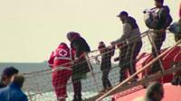 Rescued migrants including children