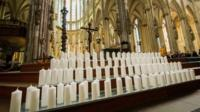 Candles on the steps in front of the altar in Cologne Cathedral