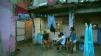 One of the families fighting eviction from Vila Autódromo in the ruins of a house