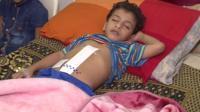 Boy in hospital bed
