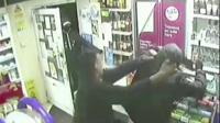 Shopkeeper wrestling robber