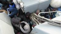 Migrants on board a boat
