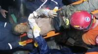 A man pulled from the rubble