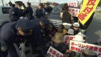 Protesters outside Okinawa's Camp Schwab US military base