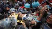 Teenager carried on a stretcher after being rescued