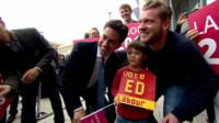 Ed Miliband with a young boy who has made a 'Vote Ed' sign out of Lego