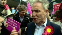 Jim Murphy campaigning in Glasgow surrounded by anti-labour protesters