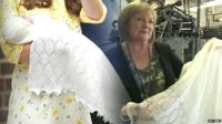 Edit of image of Princess Charlotte in arms of mother and Gillian Taylor, director of the company that produced the Princess's shawl