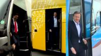 Party leaders step out of tour buses
