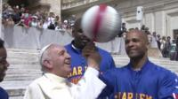 Pope Francis plays with a basketball