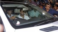 Bollywood actor Salman Khan sits in a car as he leaves a court in Mumbai, India, May 6, 2015