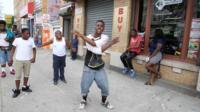 Khalil Green rapping on street