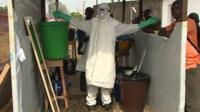 Someone wearing a protective suit