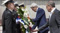 US.Secretary of State John Kerry (L) and Russian Foreign Minister Sergey Lavrov (R) lay a wreath at the Zakovkzalny War Memorial in Sochi