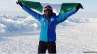 Tuedon Morgan raises the Nigerian flag at the North Pole