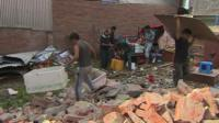 People searching rubble