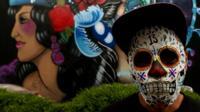 artist wearing skull mask