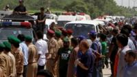 Ambulances carry bodies