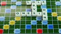 Scrabble board with new words Lolz, Obvs, Onesie on it.