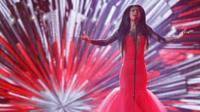 Latvia's Aminata Savadogo performs the song 'Love Injected'