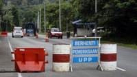 A check point is seen at the entry point to Malaysia - Thailand border in Wang Kelian, Malaysia on Sunday, May 24, 2015.