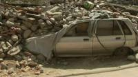 Damaged car covered in debris from Nepal earthquake