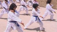 Children in Pakistan practice martial arts