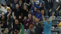 Fan catches bat at St Paul Saints baseball game