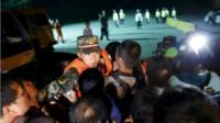 Family members of passengers of a sunken cruise ship push a cordon