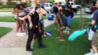 police officer pulls out his gun
