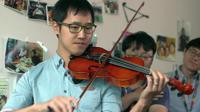 A Samsung employee playing a violin