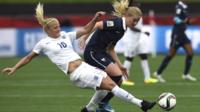 France's Amandine Henry is tackled by England's Katie Chapman