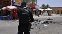 Member of Egyptian security force at scene of suicide attack in Luxor