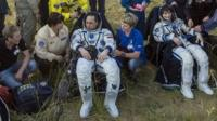 Russian cosmonaut Anton Shkaplerov and European Space Agency astronaut Samantha Cristoforetti rest after landing