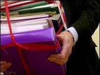 Man holding documents held in red tape