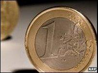 A one euro coin is pictured with a pound coin
