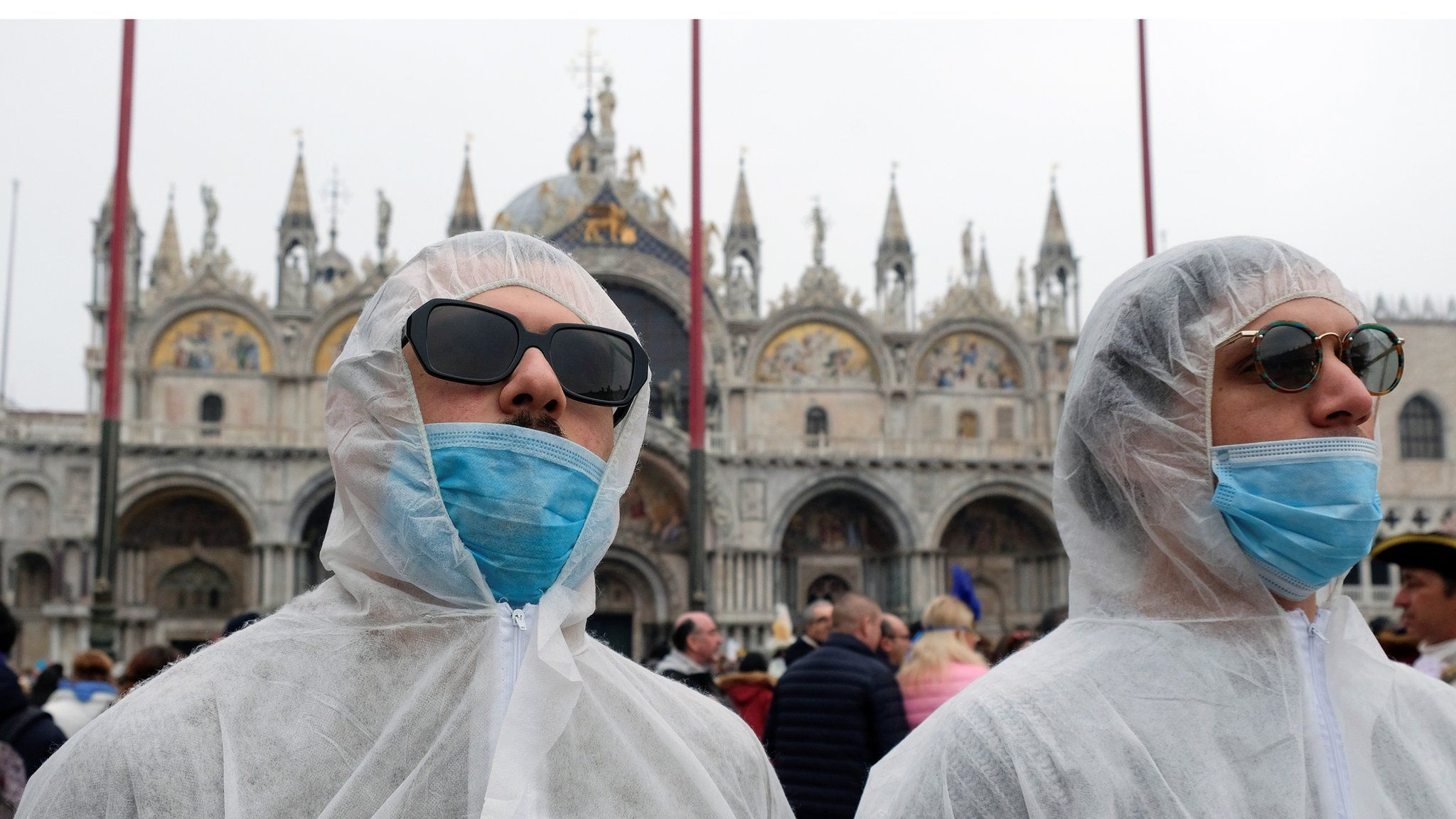 Tourists wear protective face masks at Venice Carnival