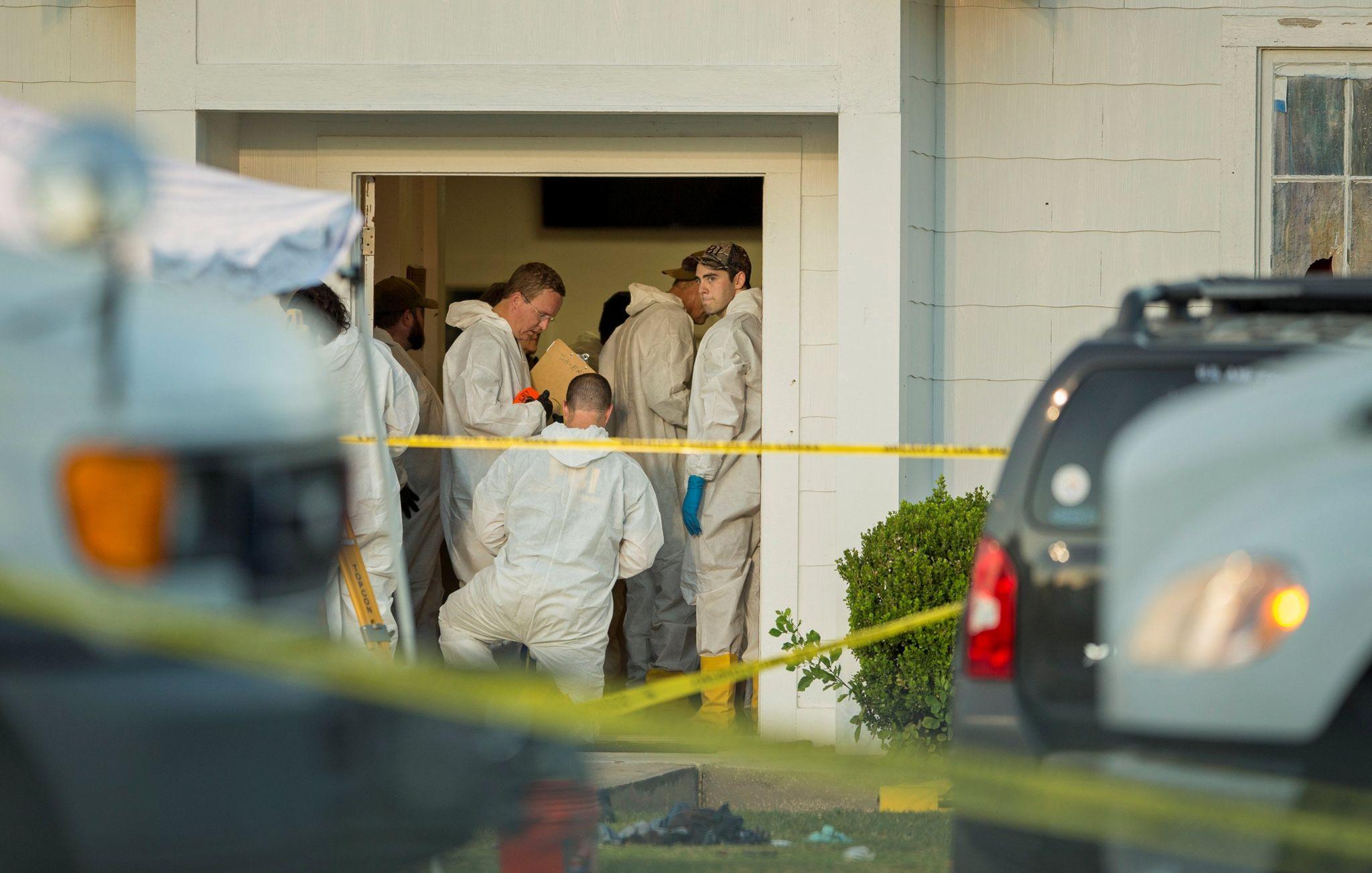 Law enforcement officials investigating