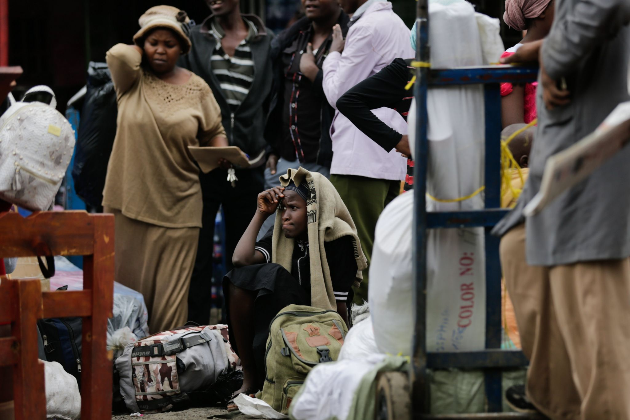 Kenyans wait in central Nairobi for buses to arrive to take them to rural homes ahead of next week's general election
