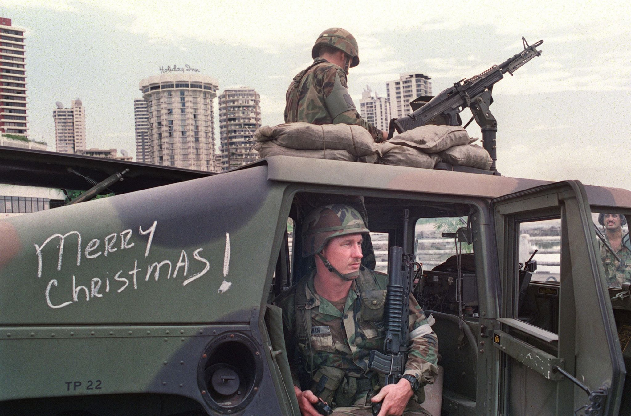 US soldiers man their security position outside the Vatican embassy in Panama City, where Panamanian General Manuel Noriega was seeking asylum, on December 25, 1989.