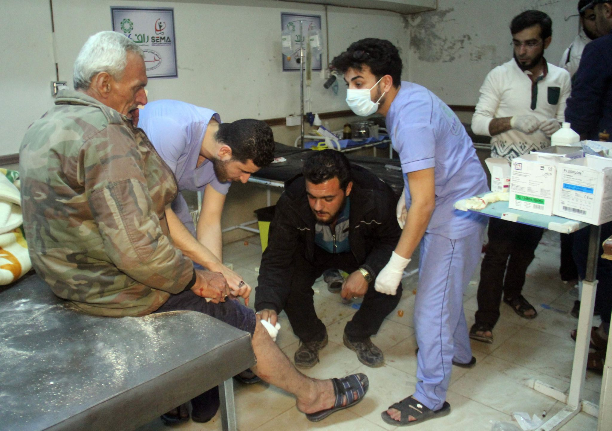 Medical staff treat a wounded victim at a hospital following air strikes that targeted Idlib on 31 May