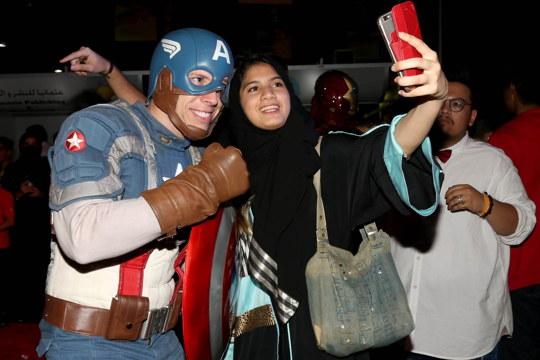 A woman poses for a selfie with a man dressed as Captain America during the Jeddah Comic Con, in Jeddah, Saudi Arabia, 16 February 2017